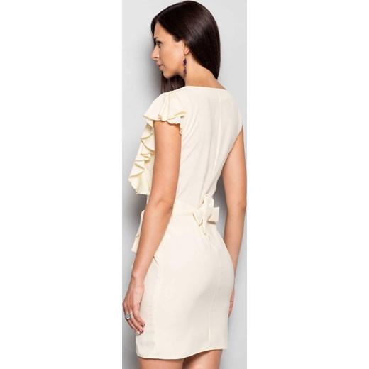 c95a9e879a ... Elegancka damska sukienka z oryginalnym rękawem kremowy the-cover bezowy  wiosna ...