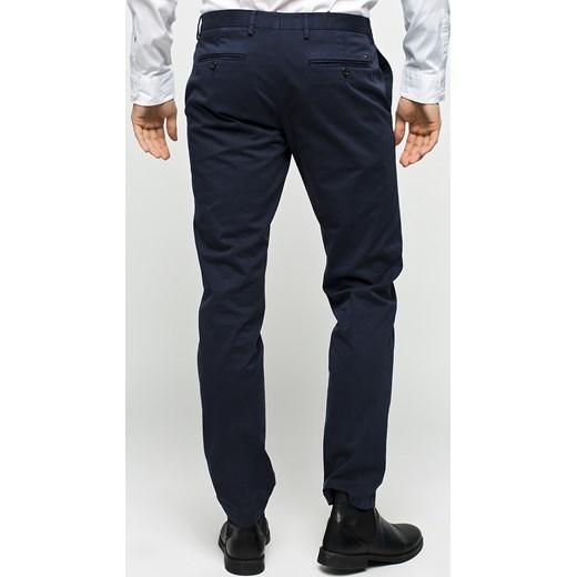 3da528b38f4b9 Spodnie męskie - Tommy Hilfiger Tailored - Spodnie William czarny Tommy  Hilfiger Tailored 54 wyprzedaż ANSWEAR ...