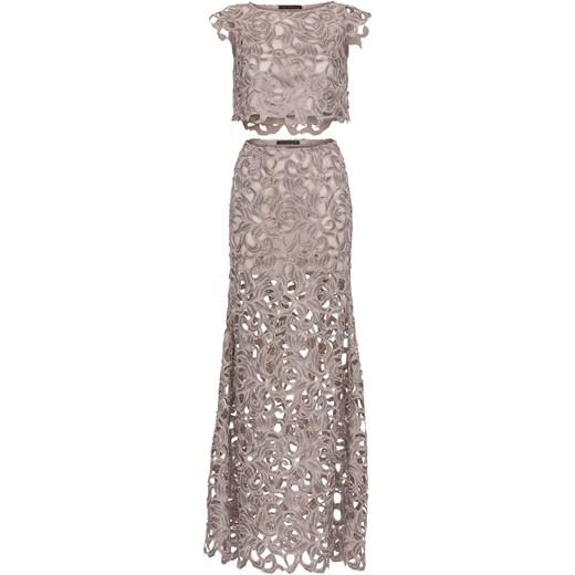 Dwuczęściowa sukienka wykonana z beżowo złotej gipiury. Le Désir