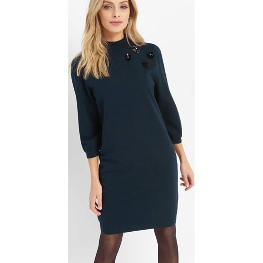 bb27ebece9d2cc Sukienka ORSAY niebieska dzianinowa oversize midi z długim rękawem w Domodi