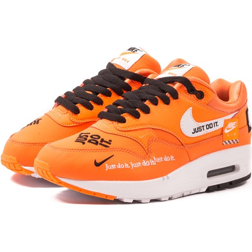 super popular 2f940 86583 Buty sportowe damskie pomarańczowe Nike gładkie w Domodi