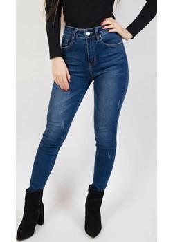 Spodnie jeansowe z małymi przetarciami  Olika olika.com.pl - kod rabatowy