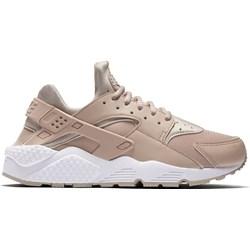 6184ea7010aa Buty sportowe damskie Nike do biegania huarache na koturnie ze skóry