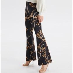 b256cc9f92450 Cropp spodnie damskie w abstrakcyjne wzory