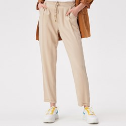 d08201921cb35 Beżowe spodnie damskie, lato 2019 w Domodi