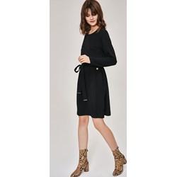 f358537925 Czarna sukienka Femestage trapezowa do pracy z okrągłym dekoltem z długim  rękawem