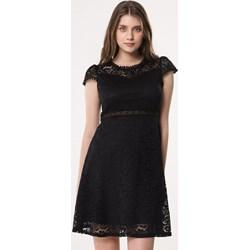 d2da6ccf50 Sukienka czarna Born2be z krótkim rękawem trapezowa mini