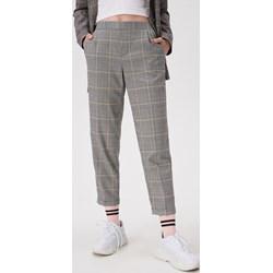 c8e9cc7ee654cb Spodnie w kratę damskie, lato 2019 w Domodi