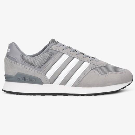 Buty sportowe damskie Adidas na płaskiej podeszwie w Domodi