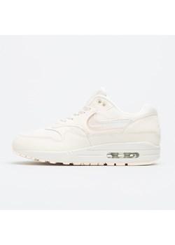 Buty sportowe damskie Nike dla biegaczy beżowe sznurowane na wiosnę gładkie na koturnie