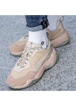 Beżowe buty sportowe damskie puma thunder, zima 2020 w Domodi