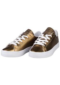 Złote trampki damskie adidas originals, wiosna 2020 w Domodi